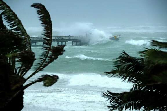 FORT LAUDERDALE, FL - SEPTEMBER 10:  Large waves produced by Hurricane Irma crash into the end of Anglins Fishing Pier September 10, 2017 in Fort Lauderdale, Florida. The category 4 hurricane made landfall in the United States in the Florida Keys at 9:10 a.m. after raking across the north coast of Cuba.  (Photo by Chip Somodevilla/Getty Images) *** BESTPIX ***