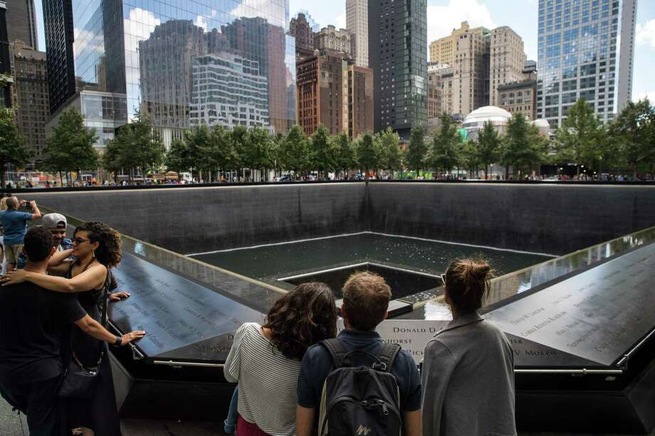 Visitors pause at the National September 11 Memorial in New York City last week as New York City was preparing to mark the 16th anniversary of the  2001 terrorist attacks. (Photo by Drew Angerer/Getty Images) Photo: Drew Angerer, Staff / 2017 Getty Images