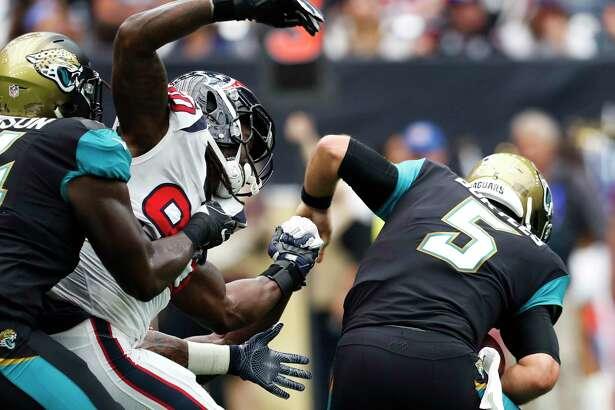 Houston Texans defensive end Jadeveon Clowney (90) pressures Jacksonville Jaguars quarterback Blake Bortles (5) during the second quarter of an NFL football game at NRG Stadium on Sunday, Sept. 10, 2017, in Houston.