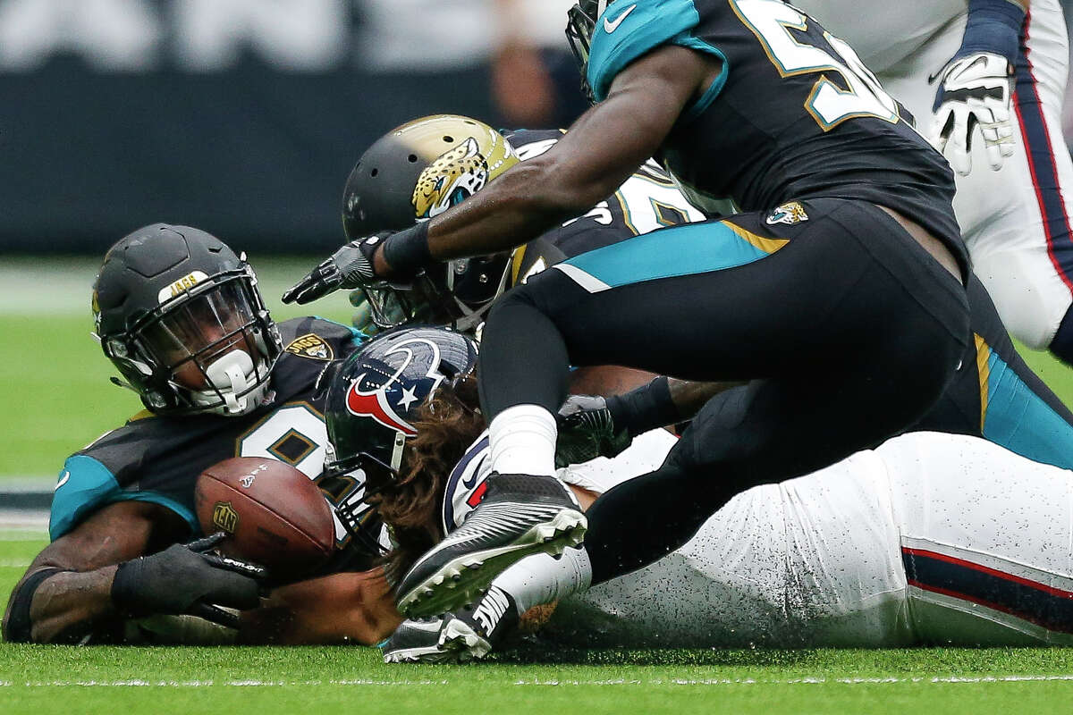 The Jacksonville Jaguars recover a fumble by Houston Texans quarterback Deshaun Watson (4) in the second half as the Houston Texans lose to the Jacksonville Jaguars 29-7 at NRG Stadium Sunday, Sept. 10, 2017 in Houston.
