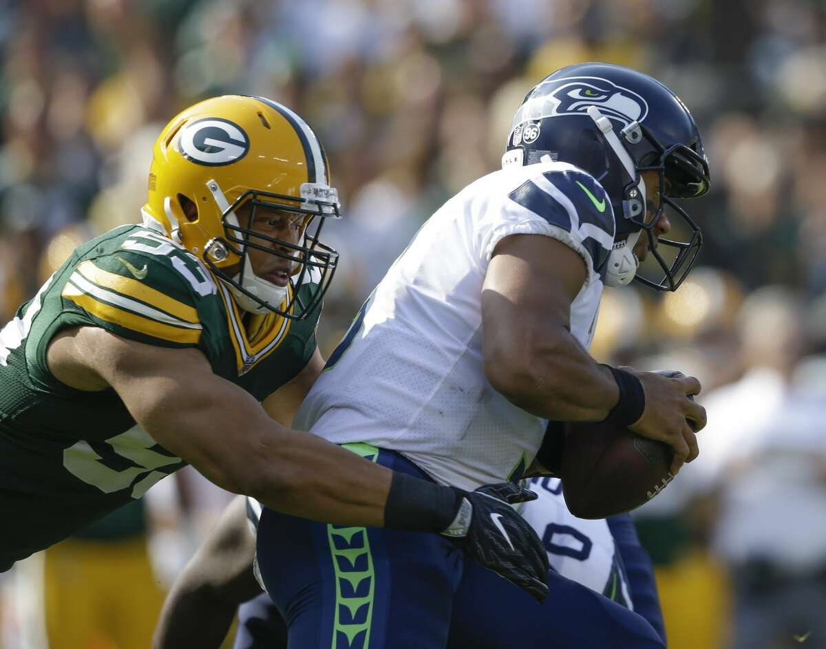 Green Bay Packers' Nick Perry sacks Seattle Seahawks' Russell Wilson during the first half of an NFL football game Sunday, Sept. 10, 2017, in Green Bay, Wis. (AP Photo/Jeffrey Phelps)