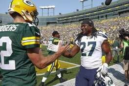 Green Bay Packers' Aaron Rodgers talks to Seattle Seahawks' Eddie Lacy before an NFL football game Sunday, Sept. 10, 2017, in Green Bay, Wis. (AP Photo/Jeffrey Phelps)