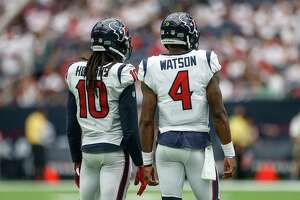 Houston Texans wide receiver DeAndre Hopkins (10) and quarterback Deshaun Watson (4) talk before taking the field in the second half as the Houston Texans lose to the Jacksonville Jaguars 29-7 at NRG Stadium Sunday, Sept. 10, 2017 in Houston.