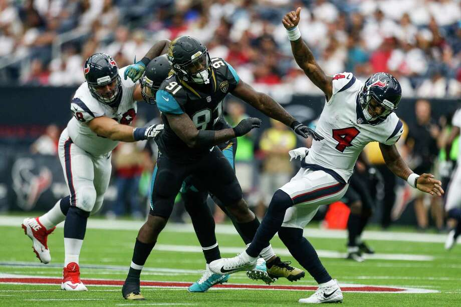 Jacksonville Jaguars defensive end Yannick Ngakoue (91) is called for roughing the passer after a late hit on Houston Texans quarterback Deshaun Watson (4) in the second half as the Houston Texans lose to the Jacksonville Jaguars 29-7 at NRG Stadium Sunday, Sept. 10, 2017 in Houston. Photo: Michael Ciaglo, Houston Chronicle / Michael Ciaglo