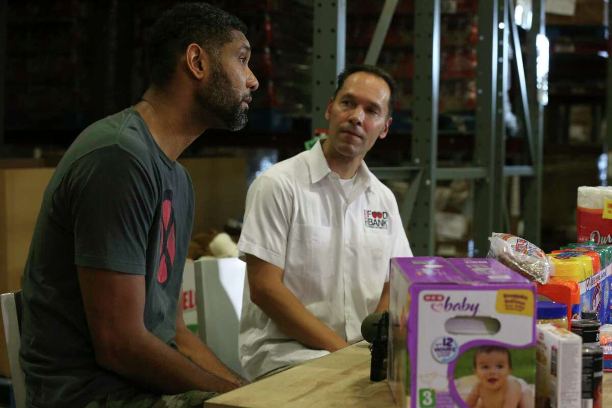 Former San Antonio Spurs player Tim Duncan, left, and San Antonio Food Bank President/CEO Eric Cooper announce a hurricane relief mission to the U.S. Virgin Islands, during a press conference Sunday, Sept. 10, 2017.