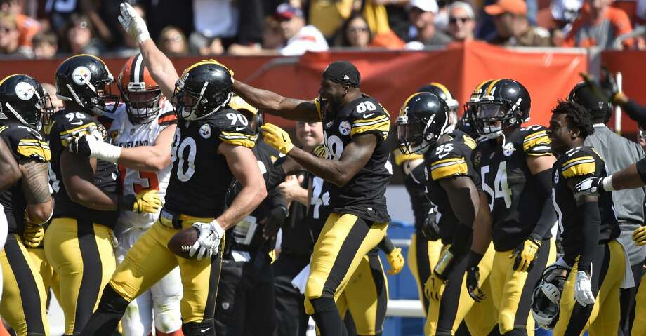 Pittsburgh Steelers linebacker T.J. Watt (90) celebrates with teammates after making an interception during the second half of an NFL football game against the Cleveland Browns, Sunday, Sept. 10, 2017, in Cleveland. (AP Photo/David Richard) Photo: David Richard/Associated Press