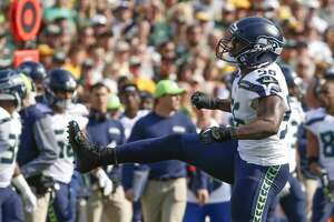 Seattle Seahawks' Cliff Avril reacts after saying Green Bay Packers' Aaron Rodgers during the first half of an NFL football game Sunday, Sept. 10, 2017, in Green Bay, Wis. (AP Photo/Mike Roemer)