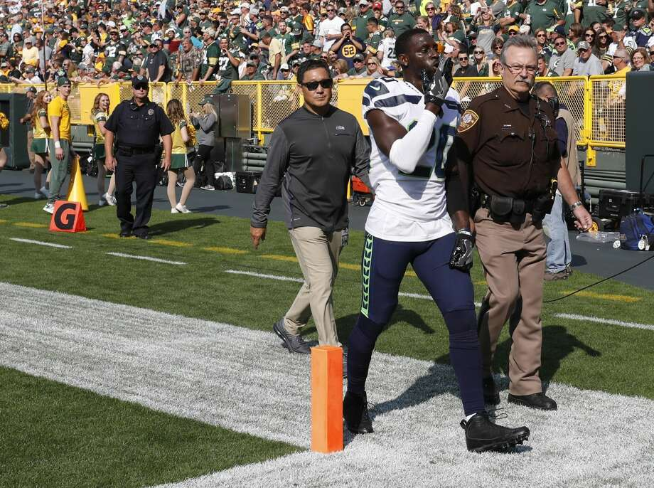 Seattle Seahawks' Jeremy Lane walks off the field after being ejected from the game during the first half of an NFL football game Sunday, Sept. 10, 2017, in Green Bay, Wis. (AP Photo/Jeffrey Phelps) Photo: Jeffrey Phelps/AP