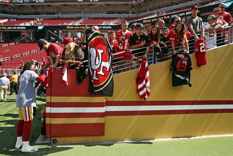 49ers defensive backAdrian Colbert signs an autograph before a home game Sept. 10. Photo: Scott Strazzante, The Chronicle
