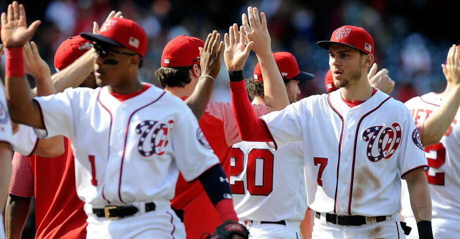 WASHINGTON, DC - SEPTEMBER 10:  Trea Turner #7 of the Washington Nationals celebrates with teammates after a 3-2 victory against the Philadelphia Phillies at Nationals Park on September 10, 2017 in Washington, DC.  (Photo by Greg Fiume/Getty Images) Photo: Greg Fiume/Getty Images