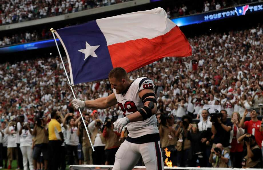 J.J. Watt #99 of the Houston Texans enters the field with Texas flag against the Jacksonville Jaguars at NRG Stadium on September 10, 2017 in Houston, Texas.  (Photo by Tim Warner/Getty Images) Photo: Tim Warner/Getty Images