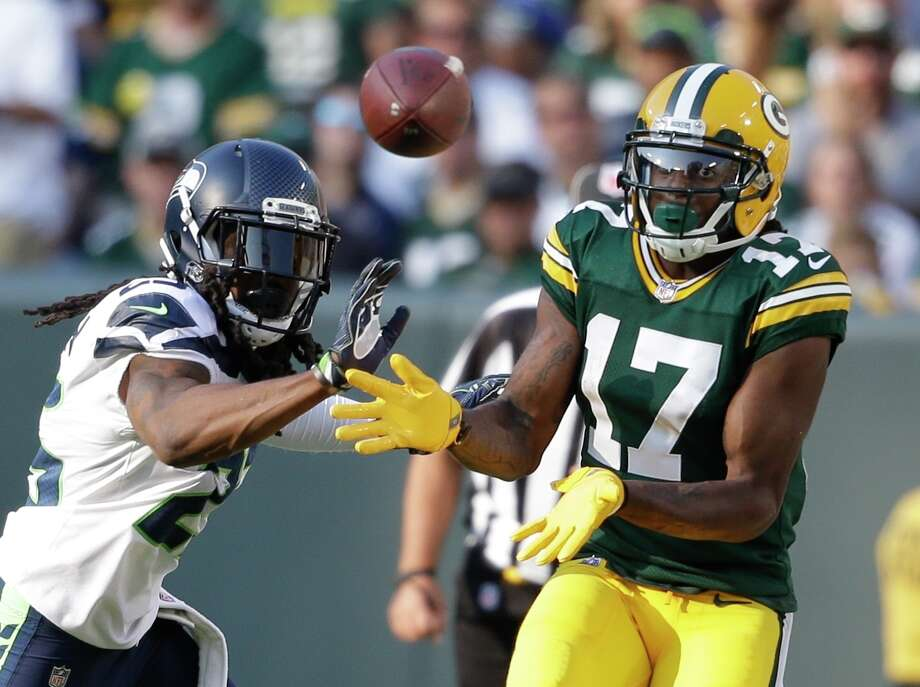 Seattle Seahawks' Richard Sherman breaks up a pass intended for Green Bay Packers' Davante Adams during the second half of an NFL football game Sunday, Sept. 10, 2017, in Green Bay, Wis. (AP Photo/Jeffrey Phelps) Photo: Jeffrey Phelps/AP