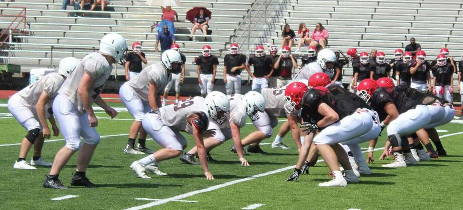 The Tarkington Longhorns (left) prepare to face the Cleveland Indians (right) during their Aug. 24 scrimmage. The Longhorns are ready to start the 2017 season with a focus on all in, all effort in everything they do for football. Photo: Jacob McAdams