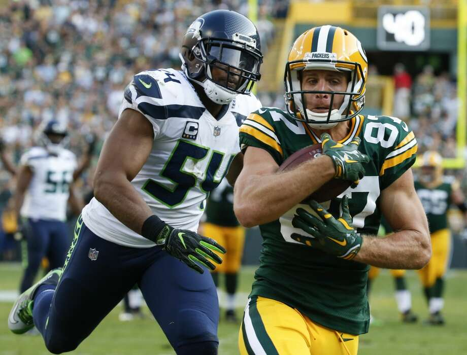 Green Bay Packers' Jordy Nelson catches a touchdown pass in front of Seattle Seahawks' Bobby Wagner during the second half of an NFL football game Sunday, Sept. 10, 2017, in Green Bay, Wis. (AP Photo/Mike Roemer) Photo: Mike Roemer/AP