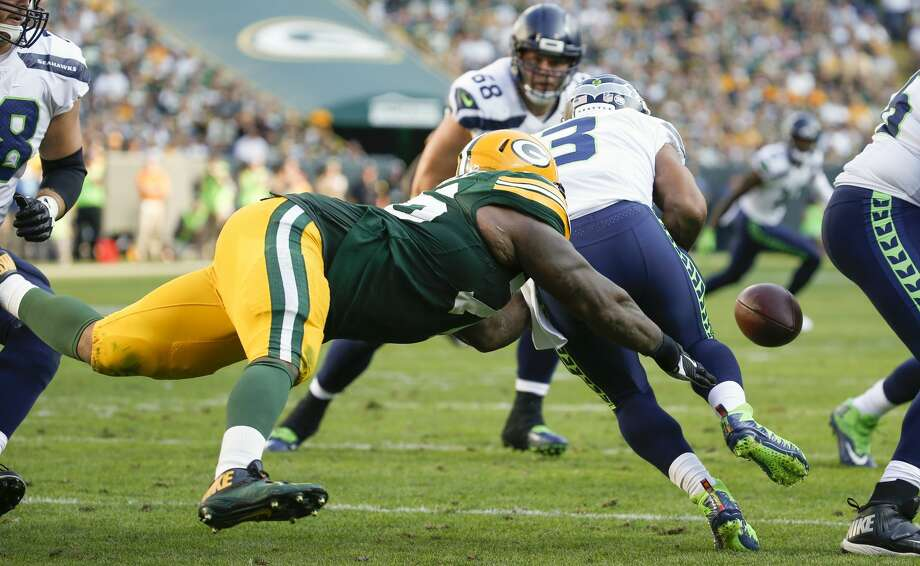 Green Bay Packers' Mike Daniels causes Seattle Seahawks' Russell Wilson to fumble during the second half of an NFL football game Sunday, Sept. 10, 2017, in Green Bay, Wis. The Packers recovered the ball. (AP Photo/Mike Roemer) Photo: Mike Roemer/AP