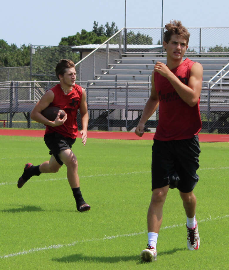 Two Trojans practice their running game after catching a punt. Photo: Jacob McAdams