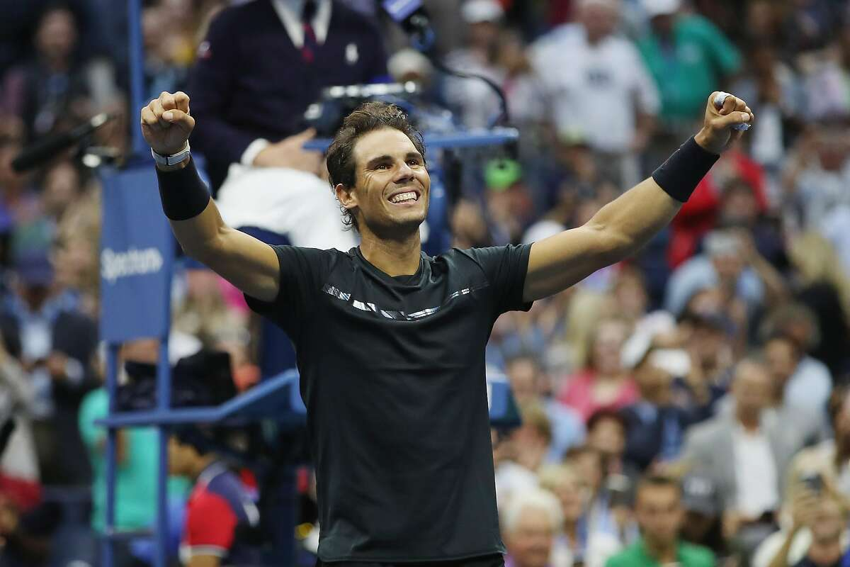 NEW YORK, NY - SEPTEMBER 10: Rafael Nadal of Spain celebrates defeating Kevin Anderson of South Africa in their Men's Singles Finals match on Day Fourteen of the 2017 US Open at the USTA Billie Jean King National Tennis Center on September 10, 2017 in the Flushing neighborhood of the Queens borough of New York City. Rafael Nadal defeated Kevin Anderson in the third set with a score of 6-3, 6-3, 6-4. (Photo by Matthew Stockman/Getty Images)