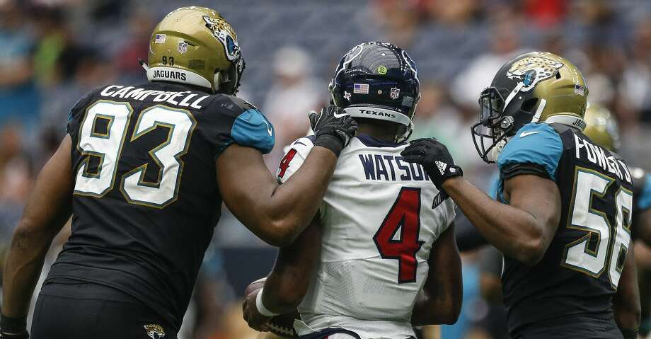 PHOTOS: Jaguars 29, Texans 7Jacksonville Jaguars defensive tackle Calais Campbell (93) and defensive end Dante Fowler (56) talk to Houston Texans quarterback Deshaun Watson (4) after the last Texans offensive possession of the game as the Houston Texans lose to the Jacksonville Jaguars 29-7 at NRG Stadium Sunday, Sept. 10, 2017 in Houston. ( Michael Ciaglo / Houston Chronicle)Browse through the photos to see action from the Texans' season-opening loss to the Jaguars on Sunday. Photo: Michael Ciaglo/Houston Chronicle