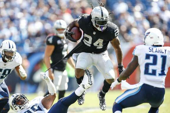 NASHVILLE, TN- SEPTEMBER 10: Running back Marshawn Lynch  #24 of the Oakland Raiders runs the ball against the Tennessee Titans in the second half at Nissan Stadium on September 10, 2017 In Nashville, Tennessee. (Photo by Wesley Hitt/Getty Images) )