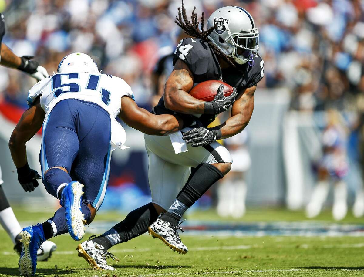 NASHVILLE, TN- SEPTEMBER 10: Running back Marshawn Lynch #24 of the Oakland Raiders runs the ball past linebacker Avery Williamson #54 of the Tennessee Titans in the first half at Nissan Stadium on September 10, 2017 In Nashville, Tennessee. (Photo by Wesley Hitt/Getty Images) )