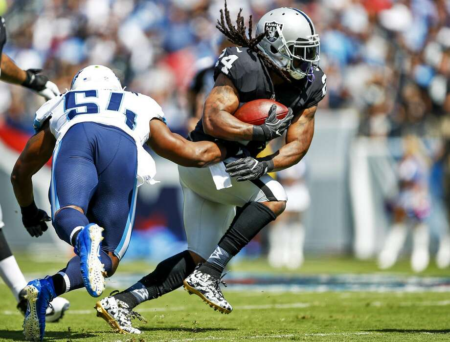 Running back Marshawn Lynch #24 of the Oakland Raiders runs the ball past linebacker Avery Williamson #54 of the Tennessee Titans in the first half at Nissan Stadium on September 10, 2017 In Nashville, Tennessee. Photo: Wesley Hitt, Getty Images