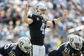 NASHVILLE, TN- SEPTEMBER 10: Quarterback Derek Carr  #4 of the Oakland Raiders gets calls a play against the Tennessee Titans in the second half  at Nissan Stadium on September 10, 2017 In Nashville, Tennessee. (Photo by Wesley Hitt/Getty Images) )