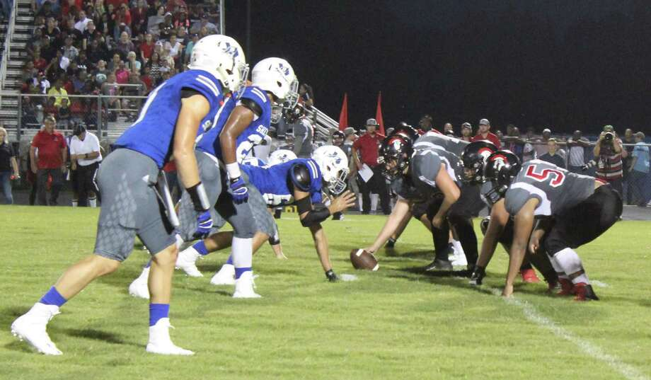 The Coldspring-Oakhurst Trojans (right) prepare to play offense against the Shepherd Pirates (left). Photo: Jacob McAdams