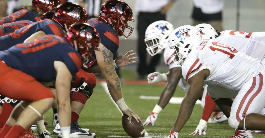 PHOTOS: UH, 19, Arizona 16Arizona lines up against Houston during an NCAA college football game, Saturday, Sept. 9, 2017, in Tucson, Ariz. Houston defeated Arizona 19-16. (AP Photo/Rick Scuteri)Browse through the photos to see action from the Cougars' season-opening win on Saturday. Photo: Rick Scuteri/Associated Press