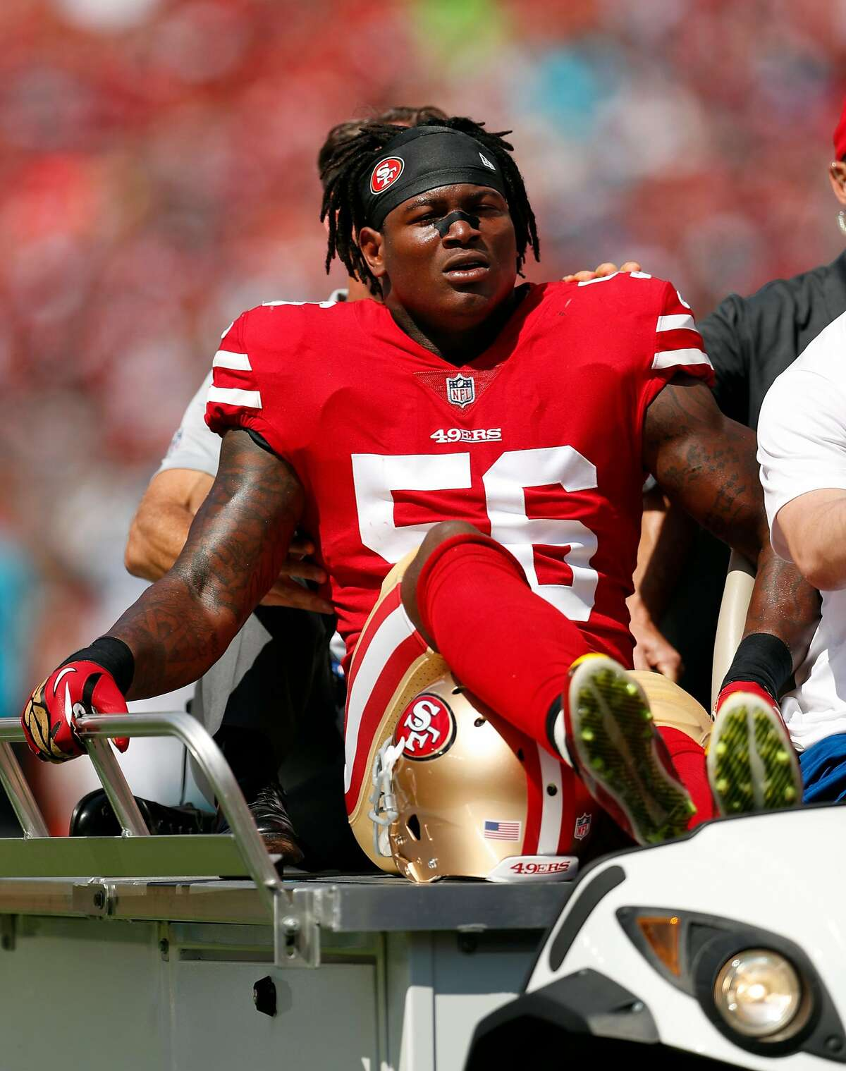San Francisco 49ers' Reuben Foster is carted off the field after he was injured in 1st quarter during NFL game at Levi's Stadium in Santa Clara, Calif., on Sunday, September 10, 2017.