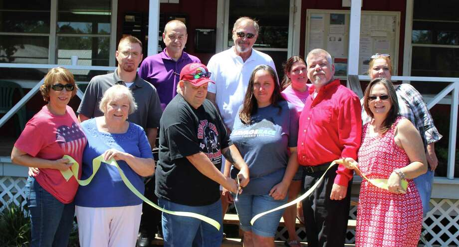 William Gunter, with wife Brandy, cuts the ribbon and accepts the plaquewelcoming Gunter Construction Service into the Coldspring/San Jacinto County Chamber of Commerce. Photo: Jacob McAdams