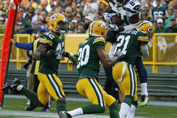 Green Bay Packers' Ha Ha Clinton-Dix (21) breaks up a pass in the end zone intended for Seattle Seahawks' Amara Darboh (84) during the second half of an NFL football game Sunday, Sept. 10, 2017, in Green Bay, Wis. (AP Photo/Mike Roemer)