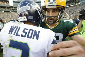 Green Bay Packers' Aaron Rodgers talks to Seattle Seahawks' Russell Wilson after an NFL football game Sunday, Sept. 10, 2017, in Green Bay, Wis. The Packers won 17-9. (AP Photo/Mike Roemer)