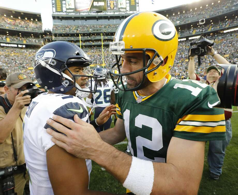 Green Bay Packers' Aaron Rodgers talks to Seattle Seahawks' Russell Wilson after an NFL football game Sunday, Sept. 10, 2017, in Green Bay, Wis. The Packers won 17-9. (AP Photo/Mike Roemer) Photo: Mike Roemer/AP