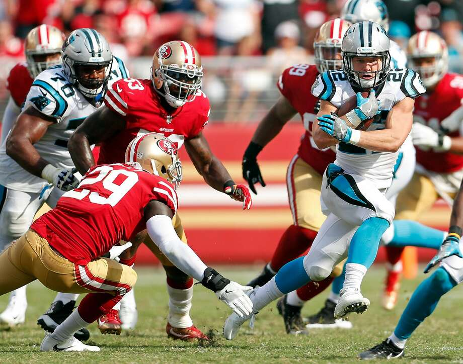Carolina Panthers' Christian McCaffrey runs for a 1st down against San Francisco 49ers' Jaquiski Tartt during Panthers' 23-3 win in NFL game at Levi's Stadium in Santa Clara, Calif., on Sunday, September 10, 2017. Photo: Scott Strazzante, The Chronicle