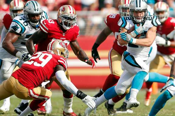 Carolina Panthers' Christian McCaffrey runs for a 1st down against San Francisco 49ers' Jaquiski Tartt during Panthers' 23-3 win in NFL game at Levi's Stadium in Santa Clara, Calif., on Sunday, September 10, 2017.