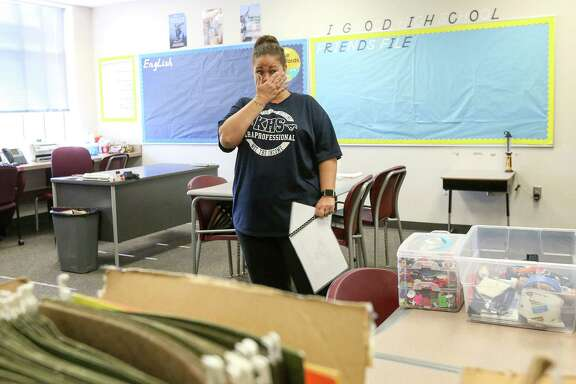 Treva Shively, a life-skills teacher from Kingwood High School, begins to cry while talking about the hardships and goodwill she has encountered after floodwaters from Tropical Storm Harvey destroyed her campus, at Summer Creek High School, Friday, Sept. 8, 2017, in Humble. Humble ISD officials planned to close Kingwood High School for the upcoming school year, and sent students and teachers to Summer Creek High School.  ( Jon Shapley  / Houston Chronicle )