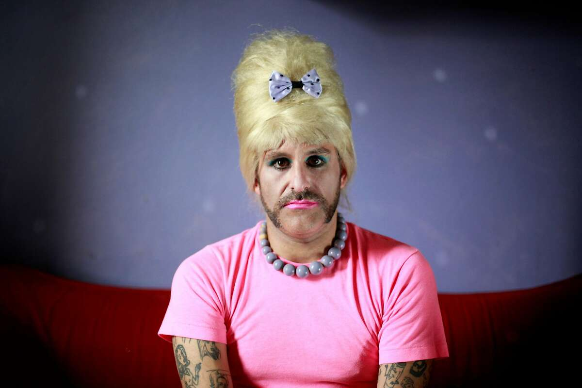 Dressed as Bubbles, Anthony Torres sits on his couch in San Francisco, Calif.