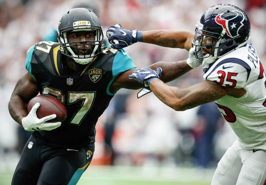 Jacksonville Jaguars running back Leonard Fournette (27) pushes off Houston Texans defensive back Eddie Pleasant (35) as he runs the ball near the goal line during the third quarter of an NFL football game at NRG Stadium on Sunday, Sept. 10, 2017, in Houston. ( Brett Coomer / Houston Chronicle ) Photo: Brett Coomer, Staff / © 2017 Houston Chronicle