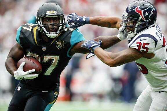Jacksonville Jaguars running back Leonard Fournette (27) pushes off Houston Texans defensive back Eddie Pleasant (35) as he runs the ball near the goal line during the third quarter of an NFL football game at NRG Stadium on Sunday, Sept. 10, 2017, in Houston. ( Brett Coomer / Houston Chronicle )