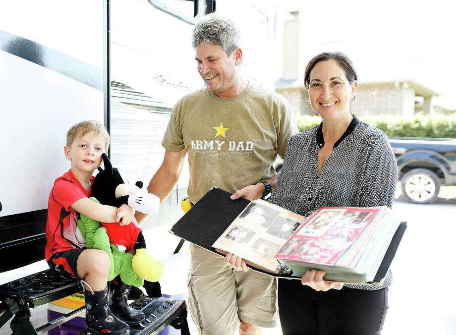 Brady Blackburn, 3, stuffed animals that his parents, Kenny and Lauren, took with the family when they evacuated from their Kingwood-area subdivision. Lauren Blackburn holds a decades-old family photo album she found safe despite the more than 2 feet of floodwater in the house. Photographed on Saturday, Sept. 9, 2017. Photo: Elizabeth Conley, Houston Chronicle / © 2017 Houston Chronicle