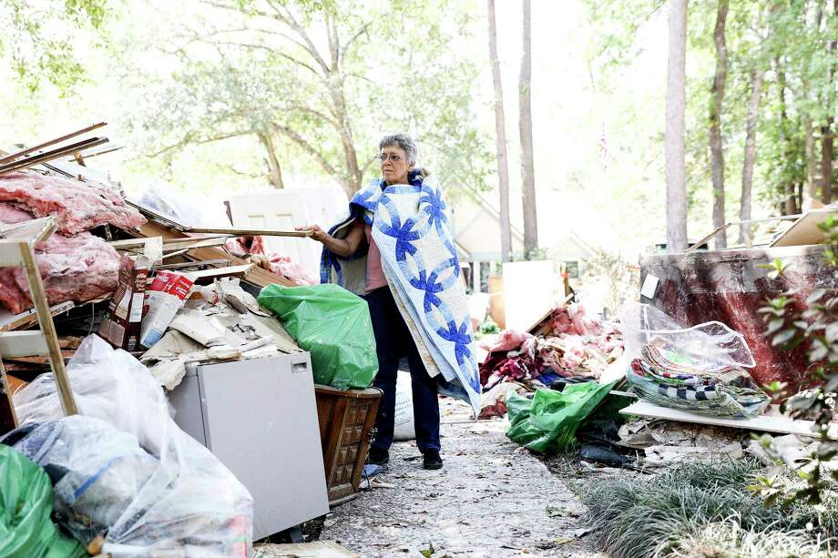 Carolyn Bennett, 70, wears a quilt she saved from Hurricane Harvey as her Kingwood home started to flood. Photographed on Saturday, Sept. 9, 2017. Photo: Elizabeth Conley, Houston Chronicle / © 2017 Houston Chronicle