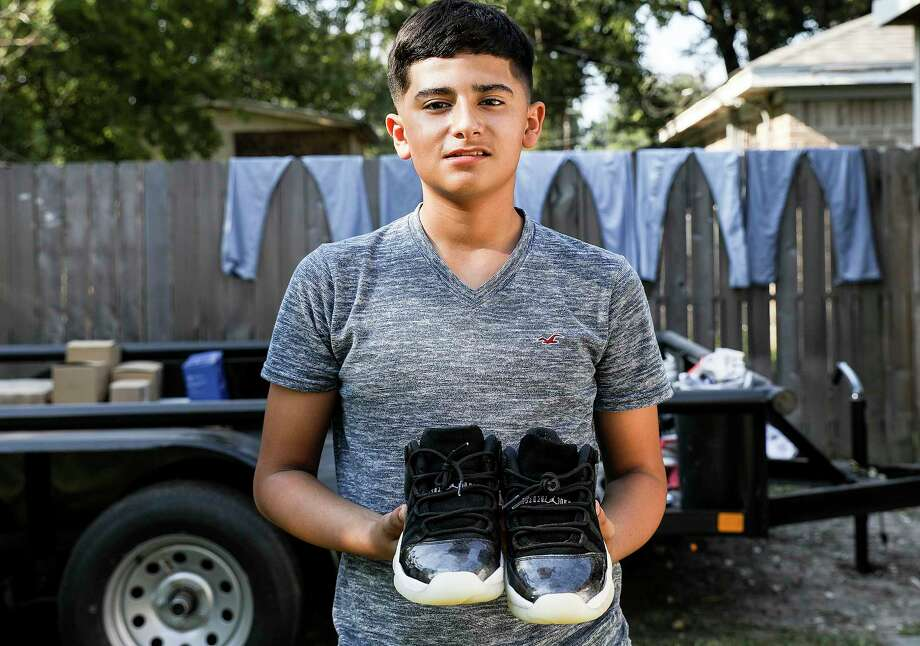 Yader Duarte, 12, holds onto his Air Jordan sneakers that stayed dry when his family's home on Houston's northside flooded from Hurricane Harvey. Photographed on Saturday, Sept. 9, 2017, in Houston. Photo: Elizabeth Conley, Houston Chronicle / © 2017 Houston Chronicle