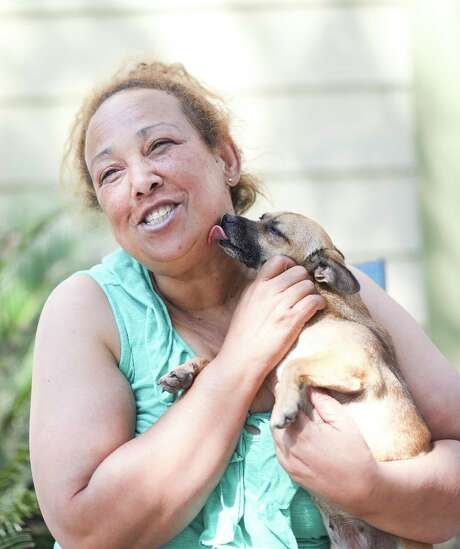 Maria Sion, holds her dog, Foxy, outside her Kashmere Gardens home on Saturday, Sept. 9, 2017 in Houston. Photo: Elizabeth Conley, Houston Chronicle / © 2017 Houston Chronicle