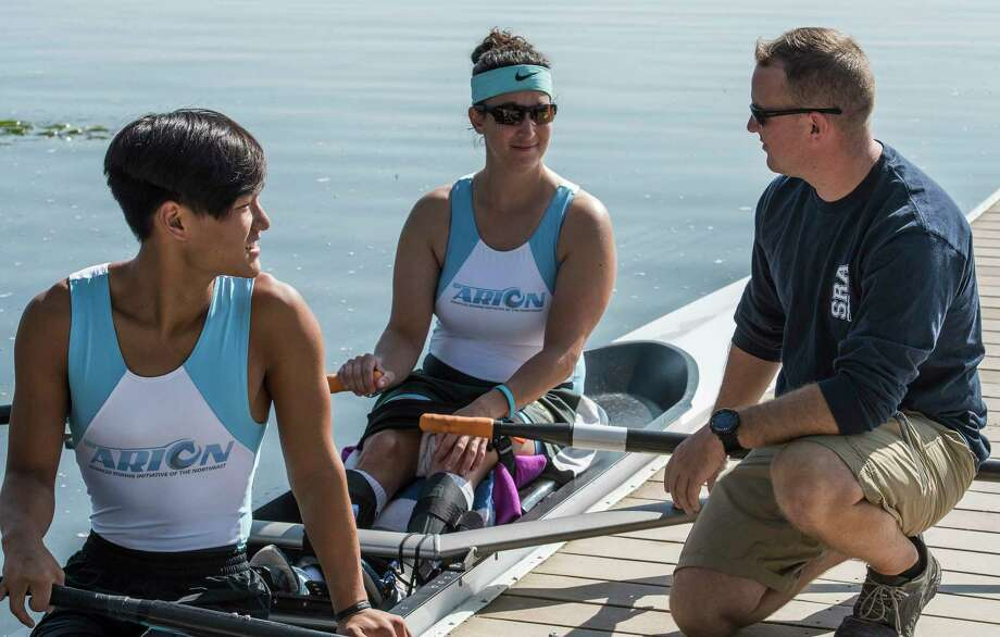 Coach Chris Meyer, right,  speaks with para rowers Isaac French, foreground, and Laura Goodkind before their practice session on Saratoga Lake Wednesday August 30, 2017 in Saratoga Springs, N.Y.  (Skip Dickstein/Times Union) Photo: SKIP DICKSTEIN, Albany Times Union / 20041362A