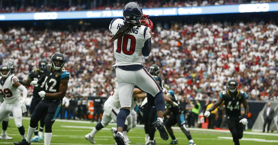 PHOTOS: Jaguars 29, Texans 7Houston Texans wide receiver DeAndre Hopkins (10) catches a touchdown pas from quarterback Deshaun Watson (4) in the second half as the Houston Texans lose to the Jacksonville Jaguars 29-7 at NRG Stadium Sunday, Sept. 10, 2017 in Houston. ( Michael Ciaglo / Houston Chronicle)Browse through the photos to see action from the Texans' season-opening loss to the Jaguars on Sunday. Photo: Michael Ciaglo/Houston Chronicle