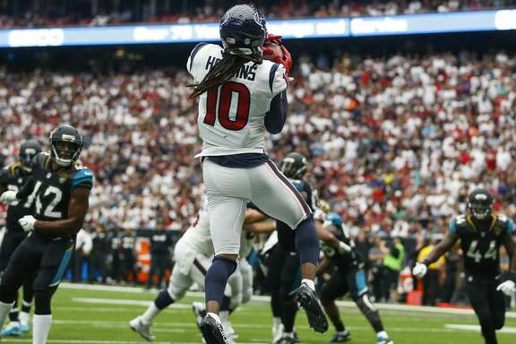 Houston Texans wide receiver DeAndre Hopkins (10) catches a touchdown pas from quarterback Deshaun Watson (4) in the second half as the Houston Texans lose to the Jacksonville Jaguars 29-7 at NRG Stadium Sunday, Sept. 10, 2017 in Houston. ( Michael Ciaglo / Houston Chronicle)