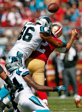 San Francisco 49ers' Brain Hoyer fumbles after being sacked by Carolina Panthers' Wes Horton in 1st quarter during NFL game at Levi's Stadium in Santa Clara, Calif., on Sunday, September 10, 2017.