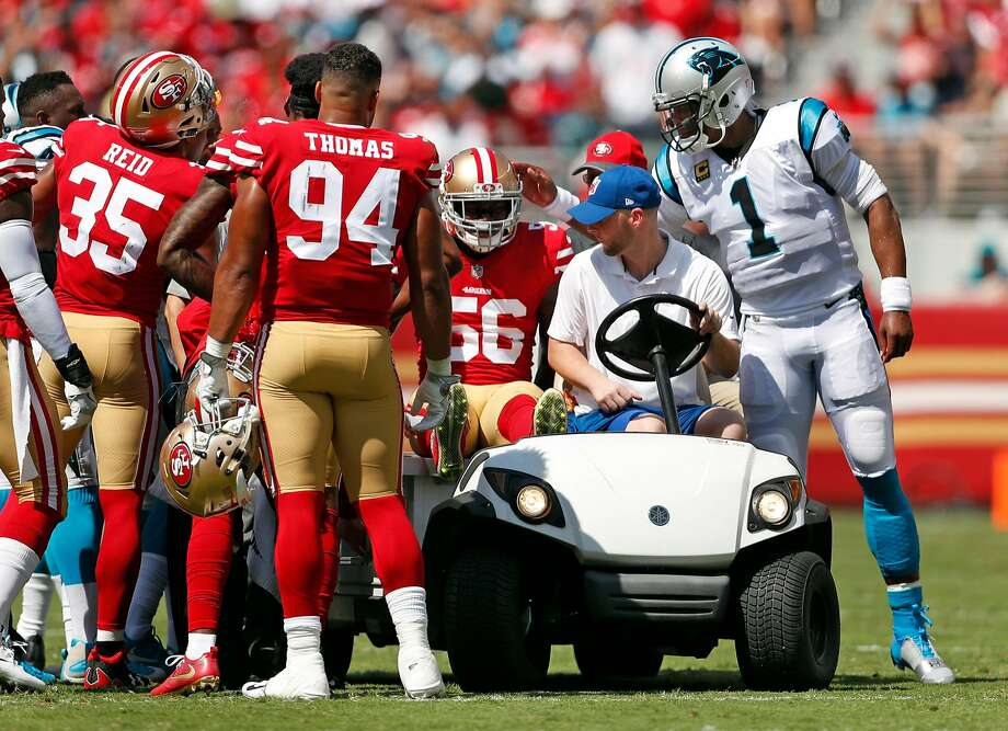 San Francisco 49ers' Reuben Foster is consoled by Carolina Panthers' Cam Newton after Foster was injured in 1st quarter during NFL game at Levi's Stadium in Santa Clara, Calif., on Sunday, September 10, 2017. Photo: Scott Strazzante, The Chronicle