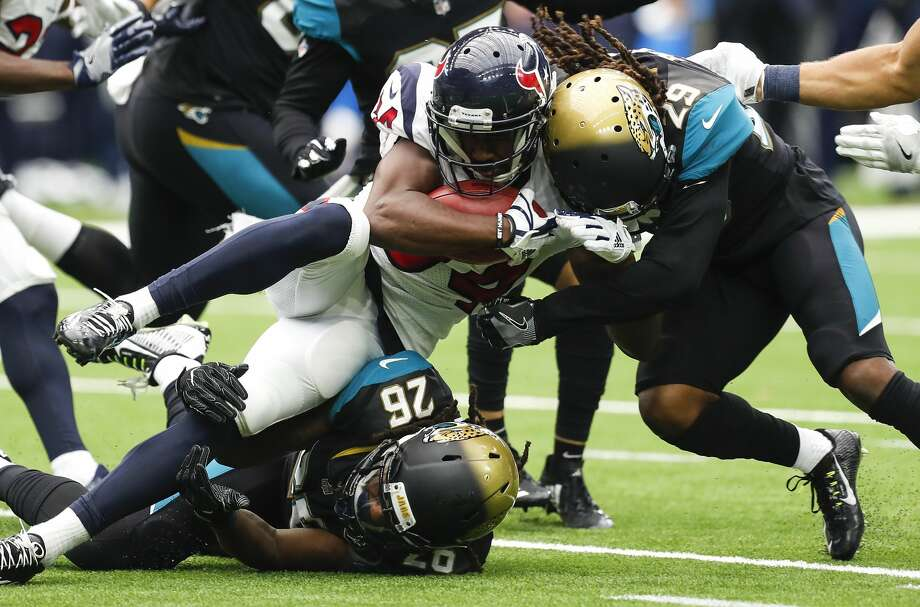 Houston Texans running back Tyler Ervin (34) is stopped by Jacksonville Jaguars cornerbacks Doran Grant (26) and Josh Johnson (29) during the fourth quarter of an NFL football game at NRG Stadium on Sunday, Sept. 10, 2017, in Houston. ( Brett Coomer / Houston Chronicle ) Photo: Brett Coomer/Houston Chronicle