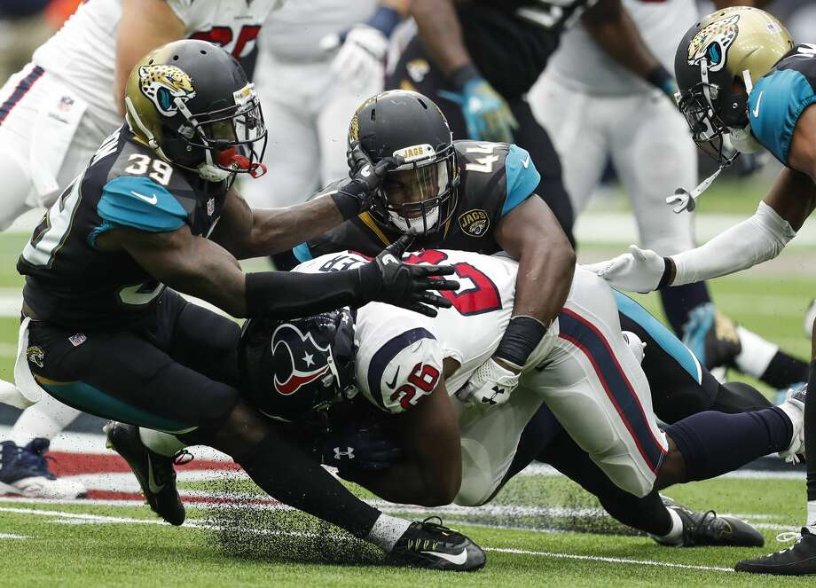 Houston Texans running back Lamar Miller (26) is stopped by Jacksonville Jaguars free safety Tashaun Gipson (39) and outside linebacker Myles Jack (44) during the third quarter of an NFL football game at NRG Stadium on Sunday, Sept. 10, 2017, in Houston. ( Brett Coomer / Houston Chronicle ) Photo: Brett Coomer/Houston Chronicle